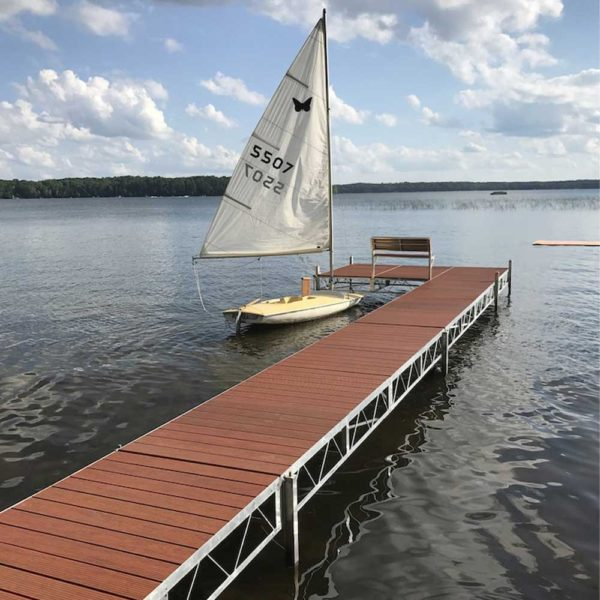 Sail boat by rolling jack dock on lake