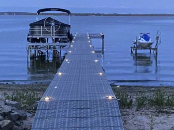 lights on a dock with a boat lift